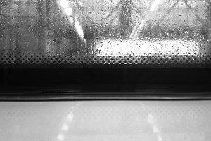 Black and white rainy trolley window