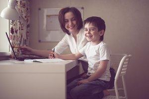 tutor teach preschooler with laptop