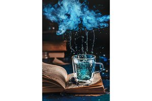 Double wall glass cup of blue tea on
