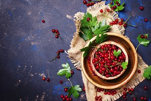 Red currant in a bowl on a canvas na