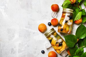 Cold drink with apricot, blueberry a