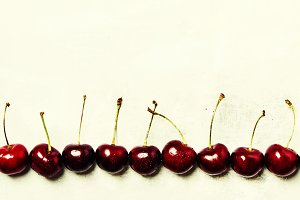 Black cherry on gray background, top