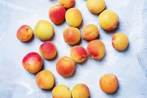 Fresh apricots on blue background, t