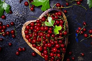 Red currants in bowl in the heart sh