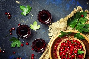 Red currant juice on a dark backgrou