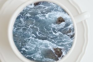 Sea and rocks in a coffee cup