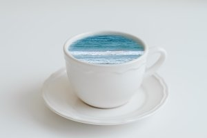 Blue sea in a coffee cup