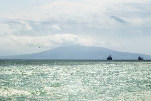 Azure waves of the Black Sea on a su