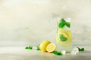 Detox water with mint, lemon on grey