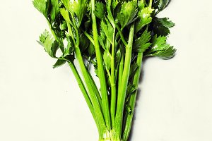 Root celery with green stems, gray b