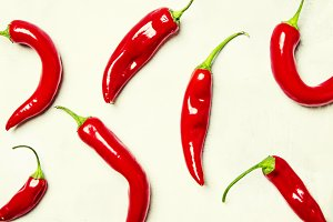 Red chili pepper on gray background,