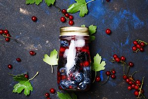 Cold berry cocktail in a bottle, top