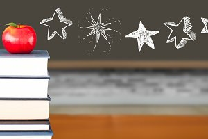 Star drawings with apple on books