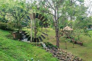 Working old wooden watermill wheel w