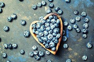 Ripe garden blueberry in a bowl, top