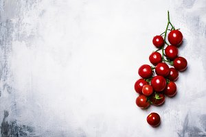 Cherry tomatoes on the vine, gray fo