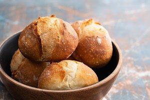 Fresh bread in a black bowl. Copy
