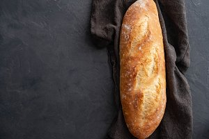 French baguette on a dark background