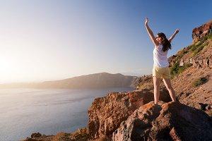 Happy woman on the rock, Santorini