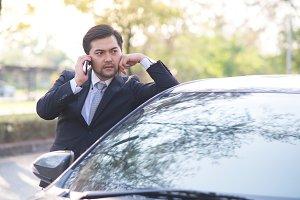 Handsome businessman using a mobile