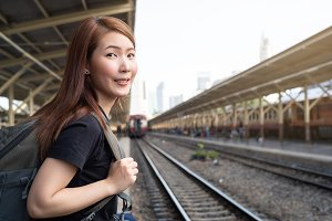 Young woman in train station