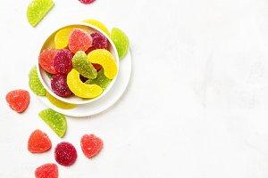 Multicolored marmalade in sugar, cop