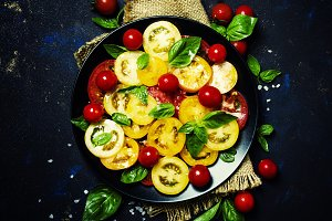Salad from colorful tomatoes, green