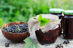 Black currants jam in a glass jar