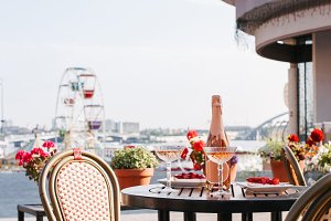 cozy outdoor cafe with champagne and