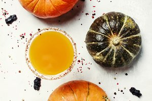 Halloween cocktail, pumpkin juice on