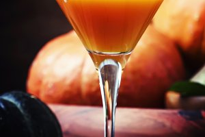 Fresh pumpkin juice in glass on a da