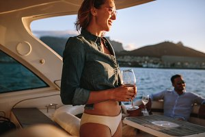 Smiling woman on yacht with friends