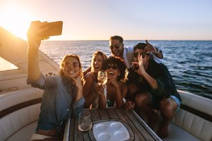 Friends posing for a selfie at boat
