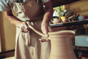 Creating a jar or vase of white clay