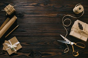 flat lay with wrapped presents, rope