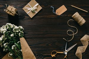 flat lay with wrapped present, bouqu