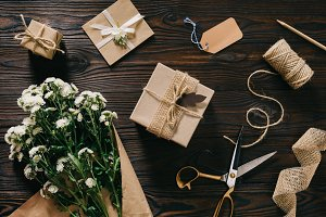 flat lay with wrapped presents, bouq