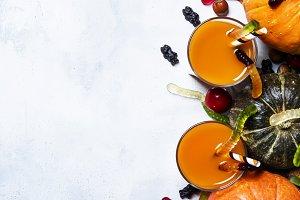 Fresh pumpkin juice on a white Hallo