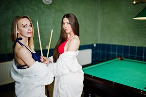 Sexy girls play pool billiard