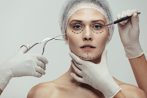 Woman having cosmetic face surgery