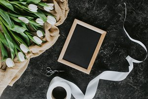 top view of white tulips, ribbon and
