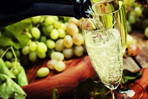 Champagne Pour In Glass, Grapes With