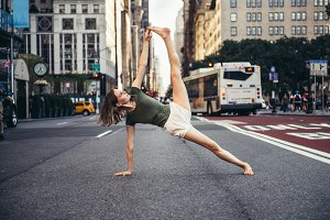 Woman doing yoga pose in the city