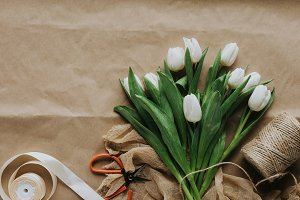 top view of white tulips with ribbon