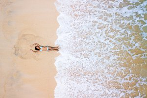 Girl on the beach from drone
