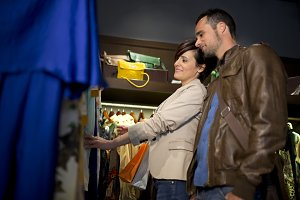 Couple buying clothes at store