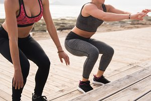Pretty healthy women doing fitness e