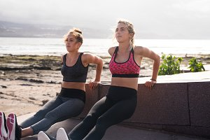 Young fit women exercising arms and