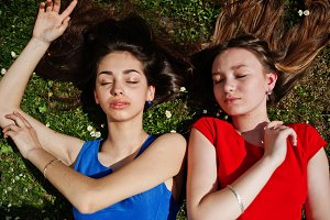Two teenagers girl in blue and red d