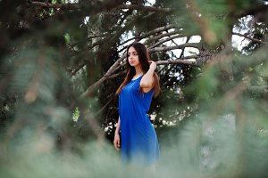 Teenage girl in blue dress posed out